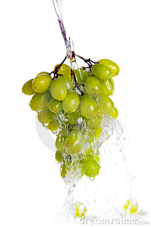 Fresh grapes under pouring water