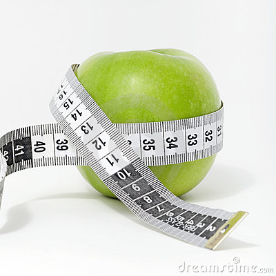 Fresh green apple with measuring tape