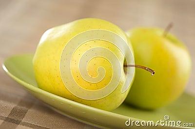 Fresh green apple on plate