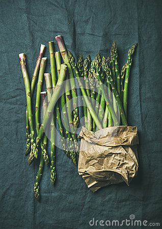 Free Fresh Green Asparagus In Craft Paper Bag Over Grey Cloth Royalty Free Stock Photography - 90738327