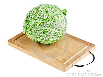Fresh green cabbage head on wooden chopping board