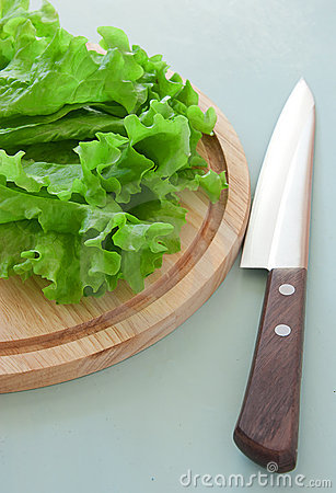 Fresh green salad with knife