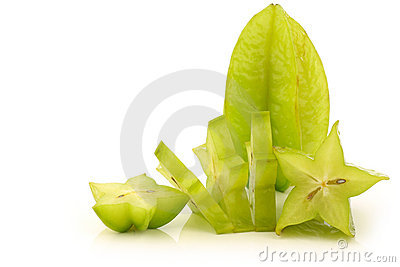 Fresh green starfruit and a cut one
