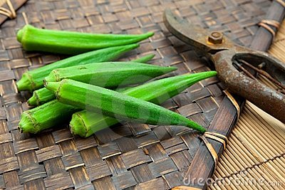 Fresh harvested okra on bamboo tray