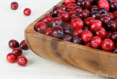 Fresh, healthy cranberries in a wooden bowl.
