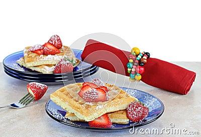 Fresh homemade waffles with strawberries