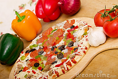 Fresh italian pizza and vegetables