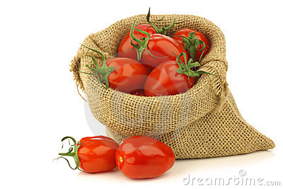 Fresh italian pomodori tomatoes in a burlap bag