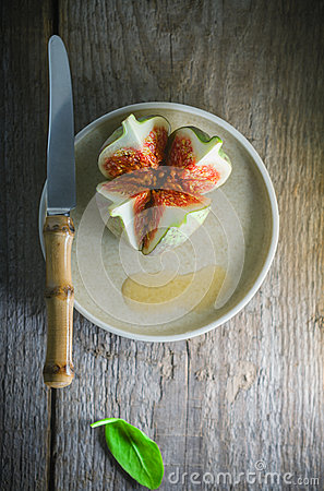 Fresh Juicy fig with a knife