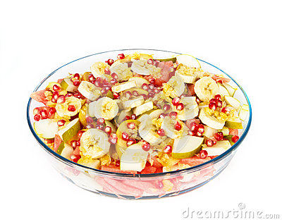 Fresh juicy fruit salad on a big plate on white
