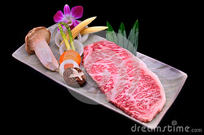 Fresh Kobe Miyazaki beef decorate with mushroom, asparagus corn,