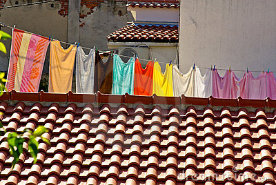 Fresh laundry hanging on a clothesline in city