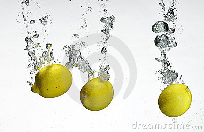 Fresh lemon dropped into water