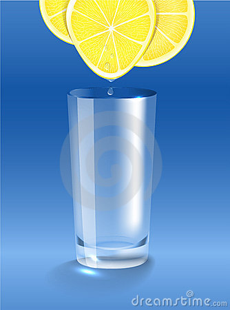 Fresh lemon juice dripping into the clean glass
