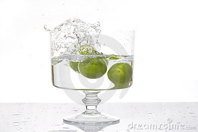 Fresh lemon splash into water