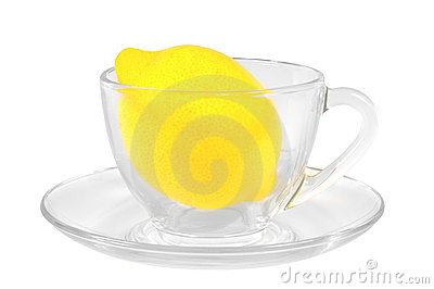 Fresh lemon in a transparent glass cup
