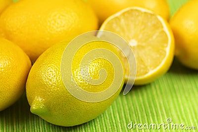 Fresh lemons over green