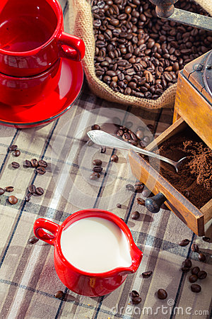 Free Fresh Milk And Ground Coffee In The Grinder Royalty Free Stock Image - 27749796