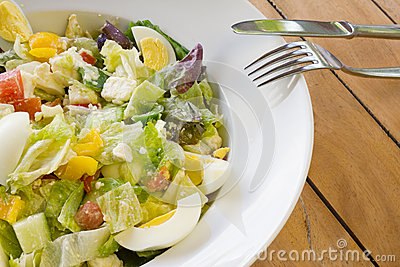 Fresh Mixed salad with fork and knife