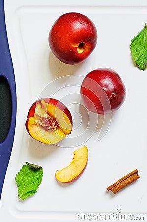 Fresh nectarines on a board