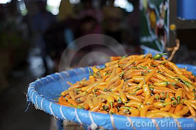 Fresh orange chili pepper at a street market