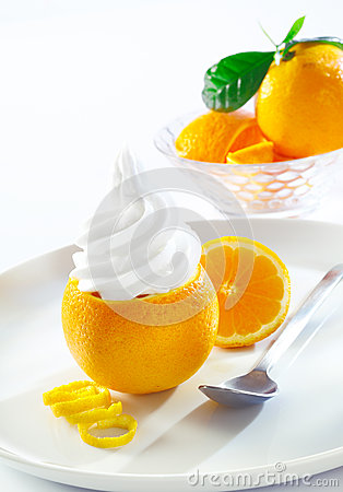 Fresh orange topped with twirling softserve