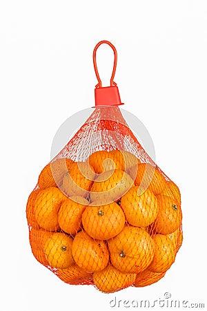 Free Fresh Oranges In Plastic Mesh Sack Isolated On White. Stock Images - 36678124