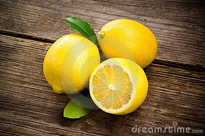 Fresh organic fruit - lemons on wood