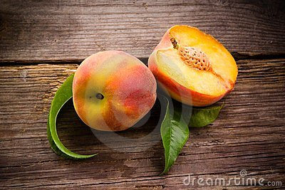 Fresh organic fruit - peaches on wood
