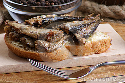 Fresh organic sprats on home made toast