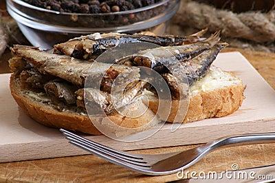 Fresh organic sprats on home made toast