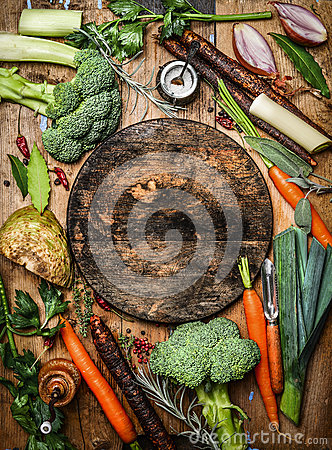 Free Fresh Organic Vegetables Ingredients For Soup Or Broth Around Round Rustic Blank Cutting Board, Top View. Stock Photos - 62144853