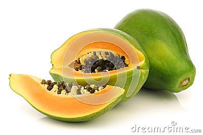 Fresh papaya fruit and a cut one