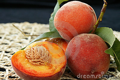 Fresh peaches with flesh and pit exposed