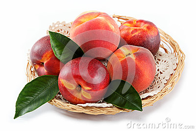 Fresh peaches and nectarines in a basket.