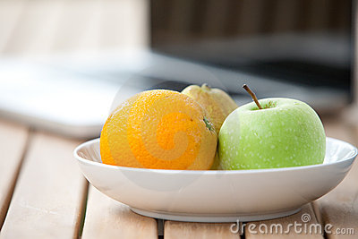 Fresh pear, orange and green apple