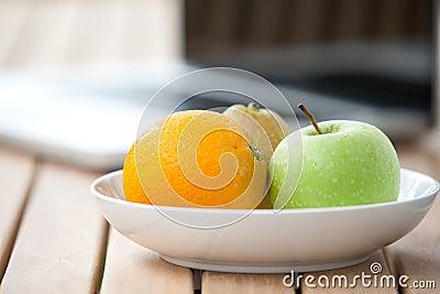Fresh pear, orange and green apple