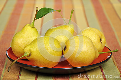 Fresh pears on plate