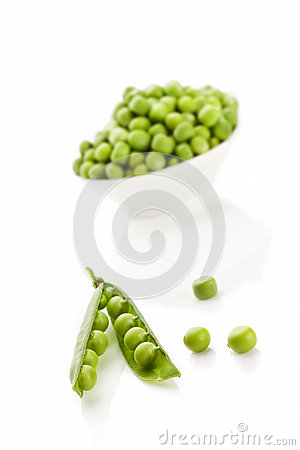 Fresh peas over white.