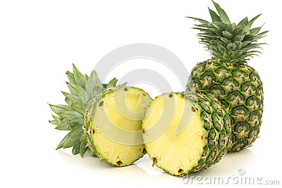 Fresh pineapple fruit and a cut one