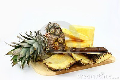 Fresh Pineapple Pieces And Knife On A Cutting Boar