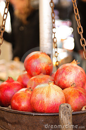 Fresh pomegranates in a metal basket