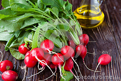 Fresh radish with leaves on the boardsand cooking oil