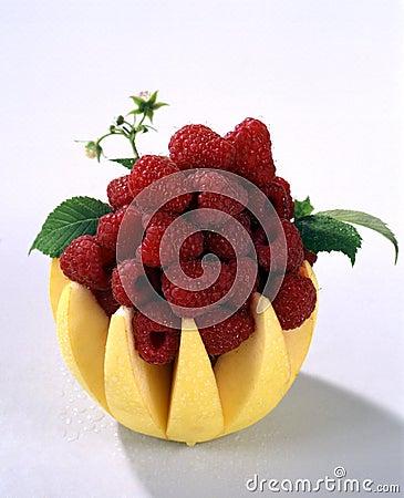 Fresh raspberries in apple