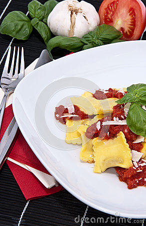 Fresh Raviolis on a plate (with ingredients)