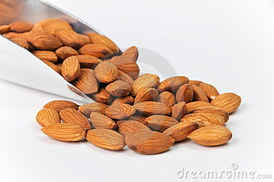 Fresh Raw Almonds in Aluminum Scoop on White