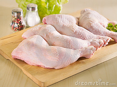 Fresh raw chicken legs arrangement
