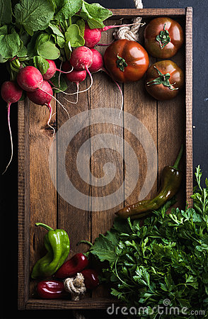 Free Fresh Raw Ingredients For Healthy Cooking Or Salad Making  In Rustic Wooden Tray Over Black Background, Top View, Copy Stock Image - 70393771