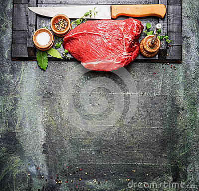 Free Fresh Raw Meat With Cooking Seasoning And Butcher Knife On Rustic Background Royalty Free Stock Photos - 64721368