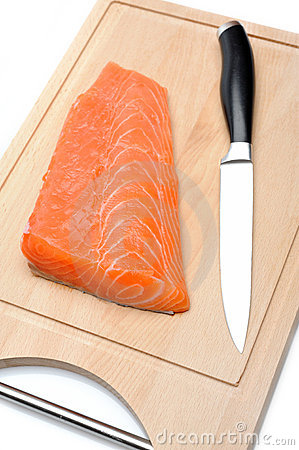 Fresh raw salmon fish on wooden board